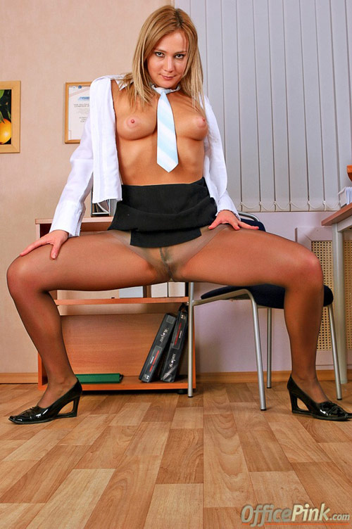 Wide spread pantyhose legs of an office slut
